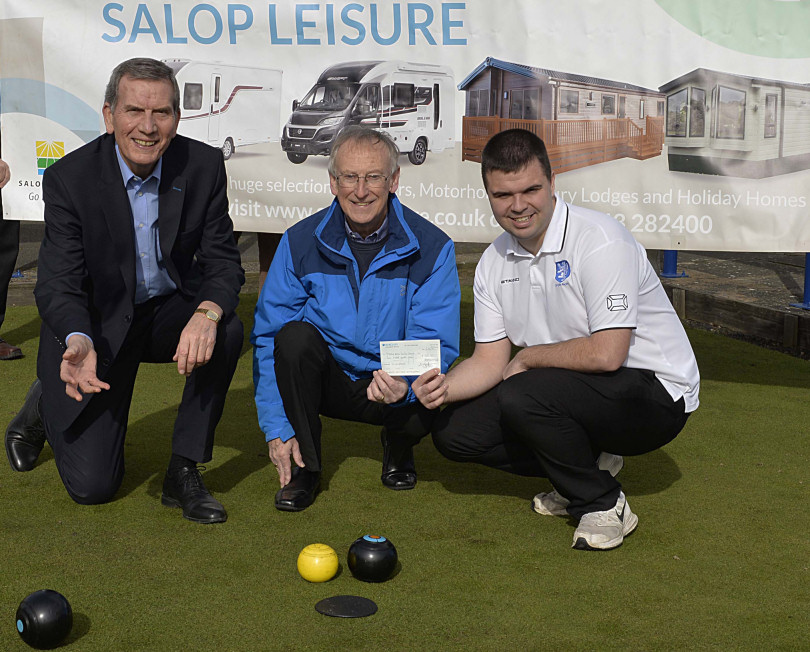 Salop Leisure's chairman Tony Bywater tries his hand at bowling watched by county delegate John Nash and treasurer Rob Burroughs from the Salop Leisure Premier Bowling League