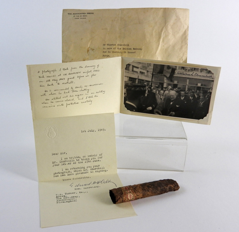 A cigar half smoked by Britain's wartime leader Sir Winston Churchill and associated photograph and letter valued at up to £2,500