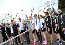 Members of the tennis academy celebrating the girls and mixed teams success