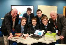Barringtons managing director Phil Wood (left) and business development manager Des Machin with the winners of an enterprise challenge at Burton Borough School in Newport