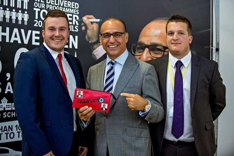 Entrepreneurs Mike (left) and Ben Dyer with Dragons Den star Theo Paphitis holding a pencil case manufactured to a design from pupils and sold in shops