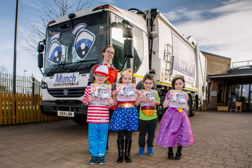 """Children with """"Munch"""" the recycling lorry, and their free books"""