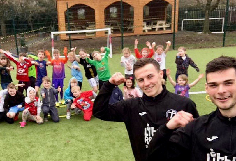Youngsters at Newport's Moorfield Primary School enjoying themselves at a holiday club with Crossbar apprentices Niall Flint and Ryan Oare