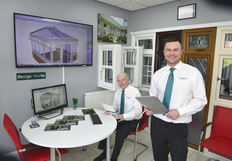Sales advisors Nick Heyhoe (seated) and Jason Richards in the Heritage Glass showrooms at Monkmoor, Shrewsbury