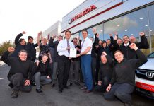 The JT Hughes team celebrate being awarded the Best Car Dealer in recent Auto Express Driver Power Awards