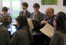 Jeremy Lund, director of music at Prestfelde School with pupils in a music lesson
