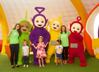 Toddlers and Barnardo's staff with the Teletubbies