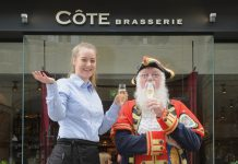 Côte Brasserie waitress Ariane Foster, 20, from Newport, with Town Crier Martin Wood at the launch party for the new restaurant in The Square, Shrewsbury
