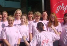 Legal staff team up outside office to support colleague in Race for Life