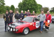 Paddock marshall John Brownlie (RIGHT) and Paul Subbiani, with drivers around the Lancia Fulvia sports car