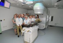 Members of staff taking a look at the new Linear Accelerator