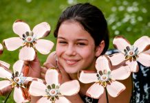 Keen fundraiser Tallulah Lewis-Schulz amongst the beautiful handcrafted flowers . Photo: Shropshire Star