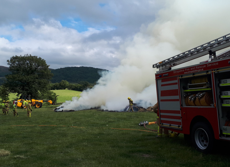 Firefighters tackle the fire involving 200 hay bales at Church Stretton. Photo: @OPUShropshire