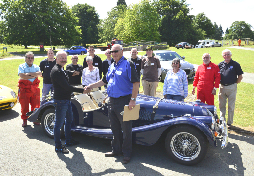 Dave West (right) and drivers welcome Norwegian visitor Ketil Storvik to Loton Park Hill Climb