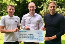David Wells, centre, presents the cheque to Ben Wootton, left, and footballer Dave Edwards, from the Little Rascals Foundation
