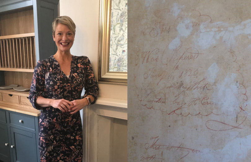 Michelle Gilchrist and the writing which has been discovered on a wall