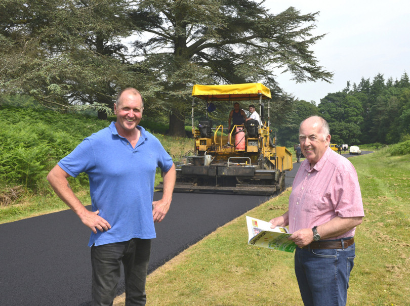 Contractor John Cottrill  with club secretary Martyn Silcox alongside the new track surface