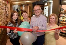 Write Here staff celebrating the re-opening, from left, Caitlin Duncan, Hilary Hannaford, John Hall and Denise Stoke