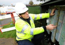 An Openreach engineer working at a fibre broadband cabinet