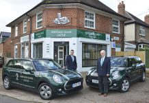 Pictured with the new Mini Clubman vehicles are customer service advisors Nick Heyhoe and Jason Richards