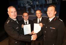 Chief Inspector Adam Thomas and Shropshire's Chief Fire Officer Rod Hammerton (right) with Shropshire's first Police Community Support Officers Steve Breese and Andy Neeves to train as on-call firefighters