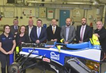 Pictured are Patrons with the F3 racing car chassis undergoing maintenance