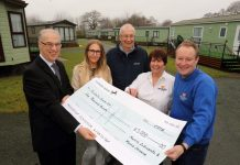 Morris Leisure's managing director Edward Goddard (right) presents a cheque for £5,000 to Roger Fallon (left of Prostate Cancer UK watched by Morris Leisure's marketing manager Sarah Lyons, prostate cancer patient Reg Spooner and Oxon Pool Holiday Home Park manager Virginia Jones