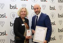 Telford's TTC Group Quality Manager David Finney receives the ISO 39001 certificate for Road Traffic Safety from Maureen Sumner Smith, Chief Operating Officer for Europe, at the British Standards Institute at their HQ in Milton Keynes