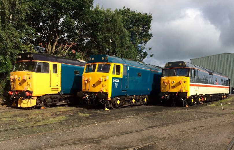 Three Class 50 engines in front of the Kidderminster Diesel Depot