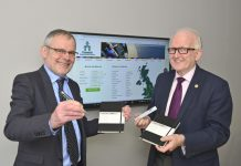 John Hall and Roderick Marsden of Travail Employment Group with some of the first branded books and pens