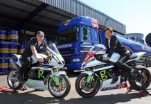 All set for the Isle of Man TT races, Barry Furber lets Gina Hinde, Morris Lubricants' marketing manager, try out one of his bikes