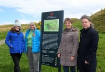 Pictured by the new sign are Annie Bethell (far left) and Helen Allen (second from right) of English Heritage, with local volunteers Neil Phillips and Maggie Rowlands