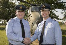 The outgoing Station Commander Group Capt Jason Appleton hands over command to Group Captain Chuck Norris (left