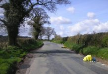 Yellow bags which were fly-tipped can be seen along the roadside in Little Wenlock.