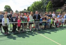 Mayor of Oswestry, Councillor Vince Hunt, watched by the Mayoress, his daughter Amber Hunt, officially re-opens the improved courts at Oswestry Team Tennis watched by members of the club