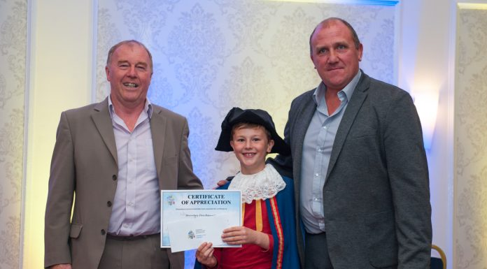 Shrewsbury First Responders collect their donation from Tom Wilks – Junior Carnival Crier. Photo: Steven Oliver Photography