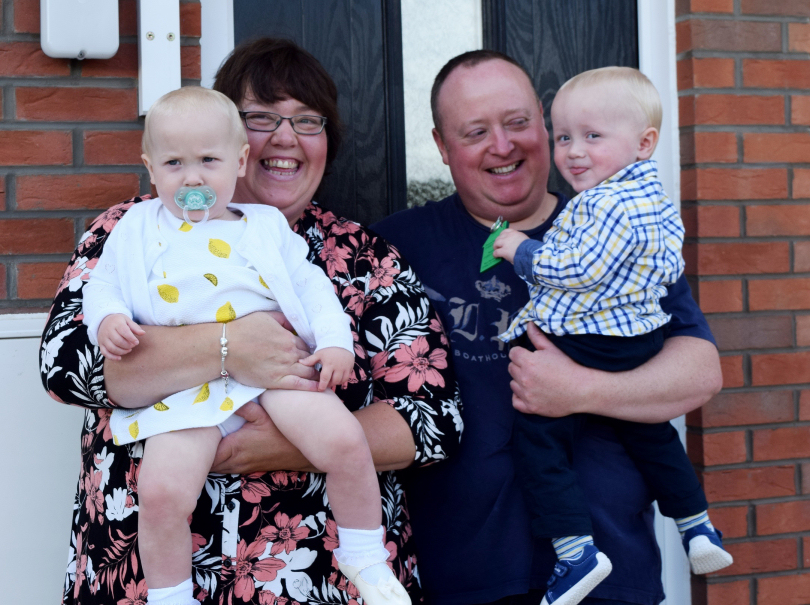 New residents Lorna James and Ian Burton with their children Maisey and Stanley