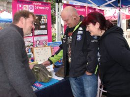 Oswestry Heritage Comics' John Swogger (left) discusses the possible origins of a carved stone found by Rachel Scotland and her partner Mark Davies