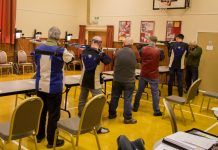 Competitors shoot at the Paper Targets In Victoria Hall