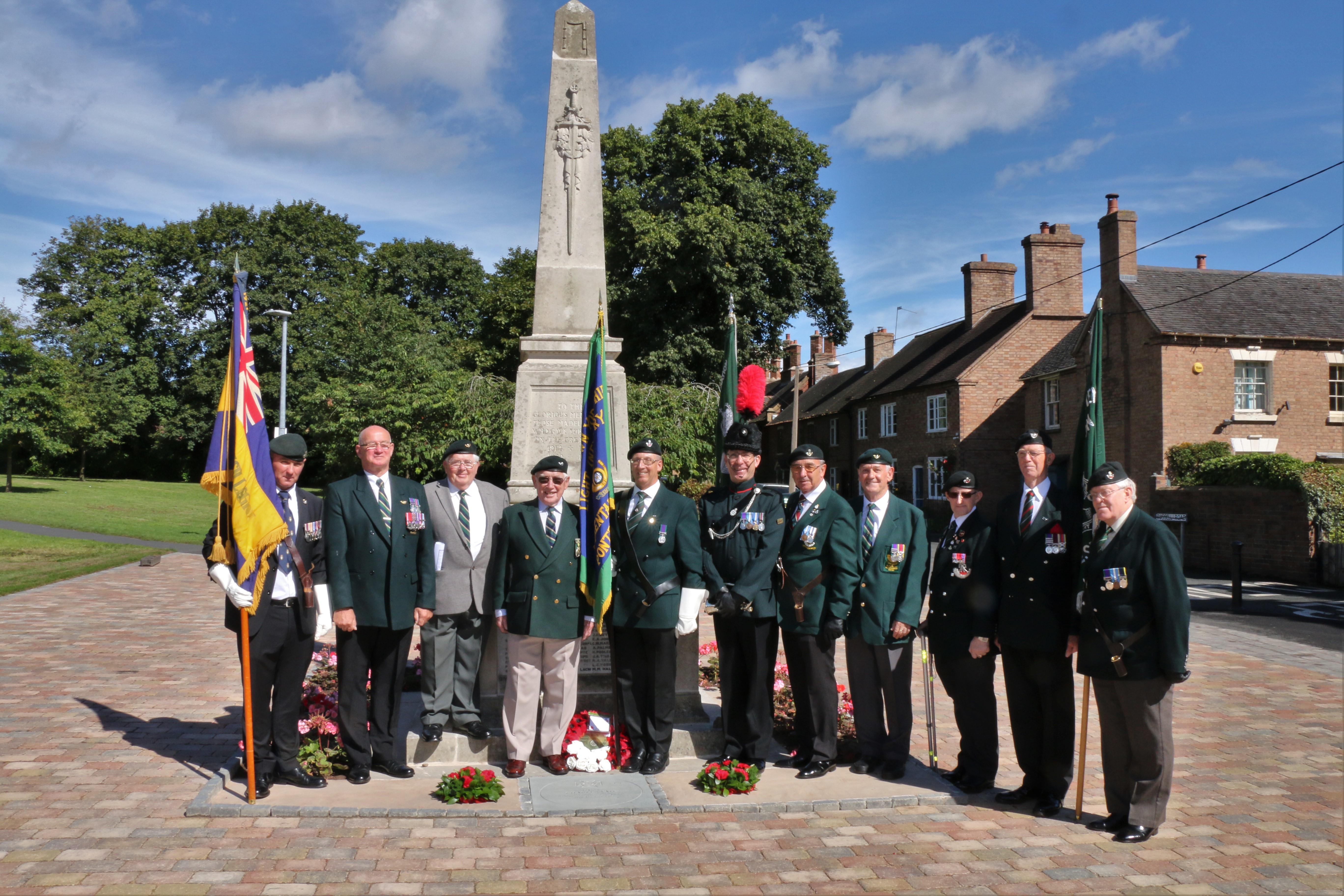 The war memorial in Madeley with members of the King's Own Yorkshire Light Infantry. The memorial and surrounding area were upgraded in 2016 with funding from the Council's Pride in Our High Streets funding scheme