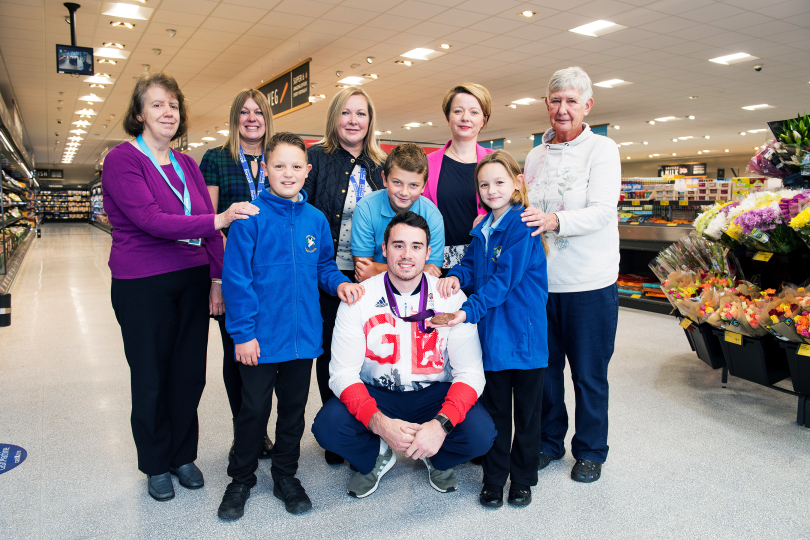 Team GB Kristian Thomas with volunteers and children from Beanstalk