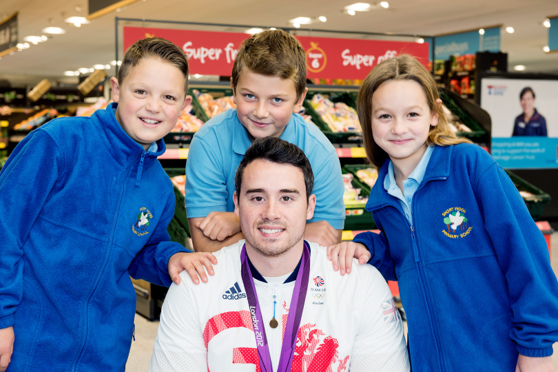 Team GB Kristian and children from Beanstalk at the new Aldi store