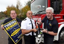 "SmartWater's Steve Mills, a former crime squad officer, shines an ultra violet light to identify stolen equipment and entrap thieves watched by Area Manager John Das Gupta, of Shropshire Fire and Rescue Service, at the scene of a ""first ever"" crime at Albrighton Fire Station"