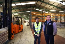 Chris Stockton (right), MD Ningbo Distribution Wrexham, at his company's new storage facility on the Whitegate Industrial Estate with the facility's new manager Sean Davies
