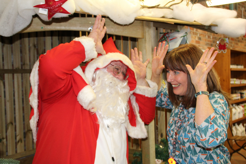 Julie Hawkins, Head of Speech and Language, takes Santa through the basics of Makaton signing with the help of Derwen College students Poppy Olsmore and Daniel Fitzroy-Ezzy