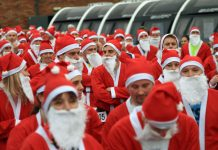 Some of the Santas line up at the start of the fun run