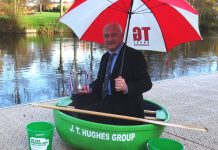 Tudor Griffiths with The Richard Bayliss Cup after TG Group raised £2,000 for Macmillan Cancer Support at the World Coracle Championships