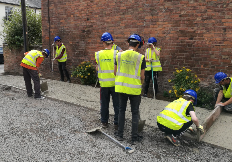 The Princes Trust volunteers at work at Hartlands care home at the Pave Aways supported project