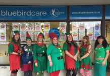 Bluebird Staff pictured infront of last year's Elf artwork are Ceri Eades, Beth Newton, Claire Flavell, Kirsty Holland, Amie Stone, Sammie Milton and Stacy Arthur