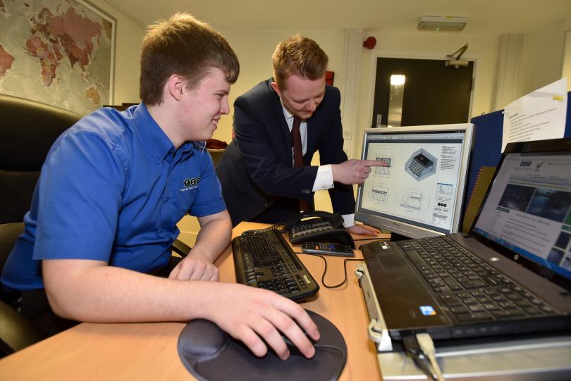 Sales apprentice Jack Loftus with his supervisor Chris Corbett